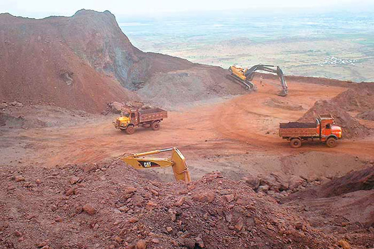 An open pit mine for bauxite (aluminum). Use as little as possible of this material, and when needed, use recycled aluminum!