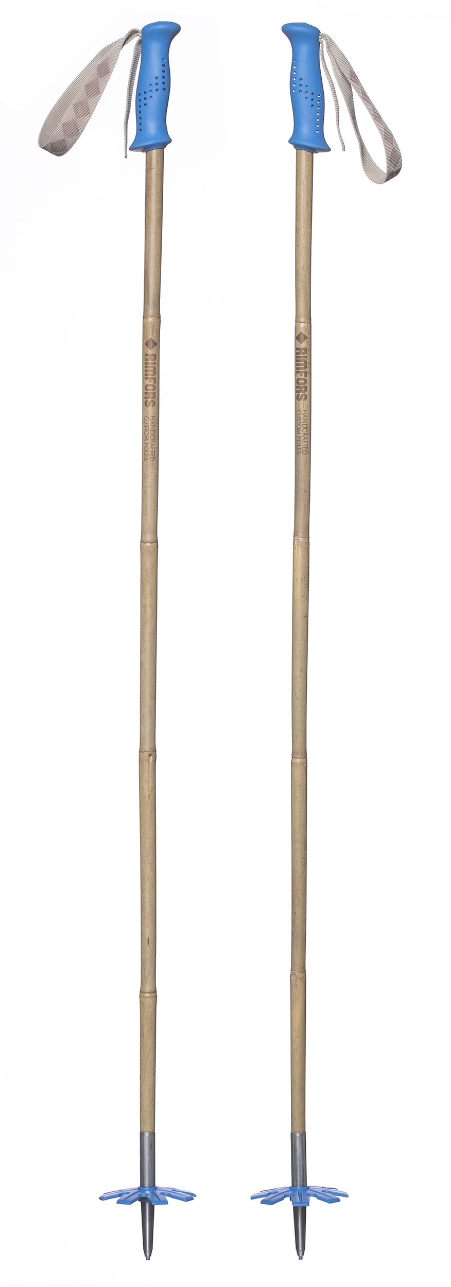 Bamboo ski poles with blue grips and baskets.
