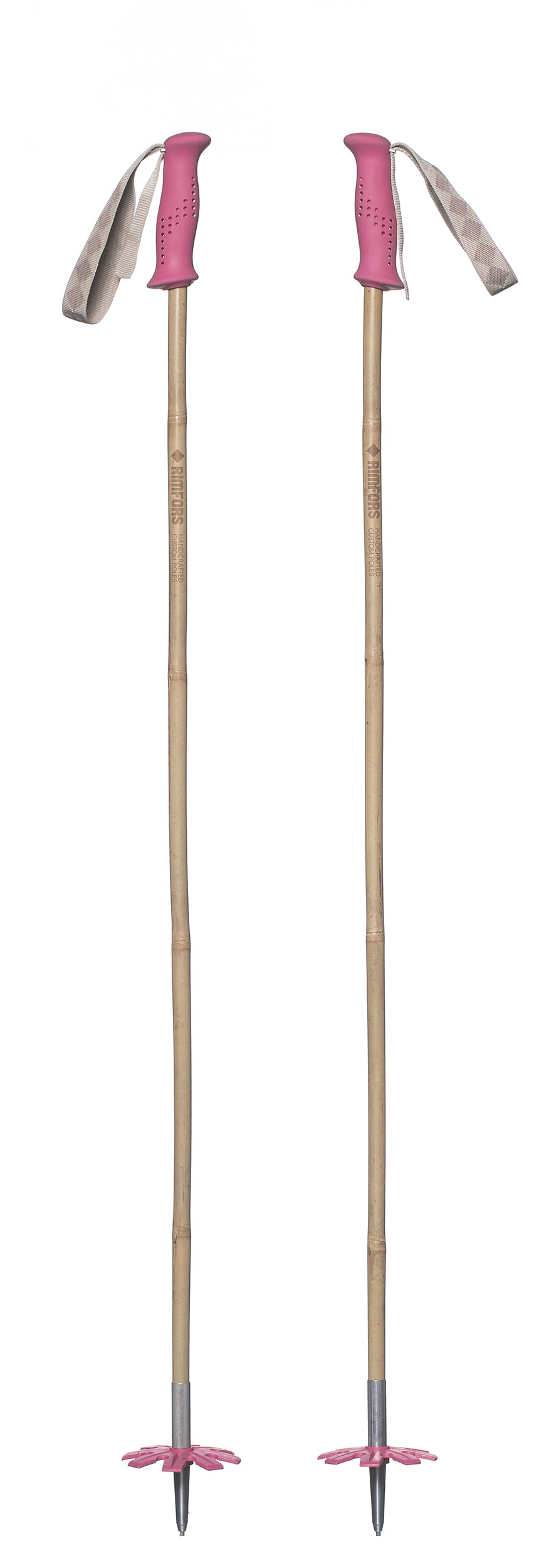 Bamboo ski poles with pink grips and baskets.