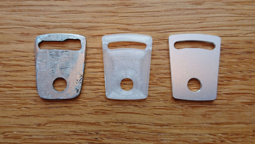 From left: my first self-made prototype from a leftover piece of metal, CAD-printed prototype in plastic, and the final prototype routed in aluminum (also from left-over material).