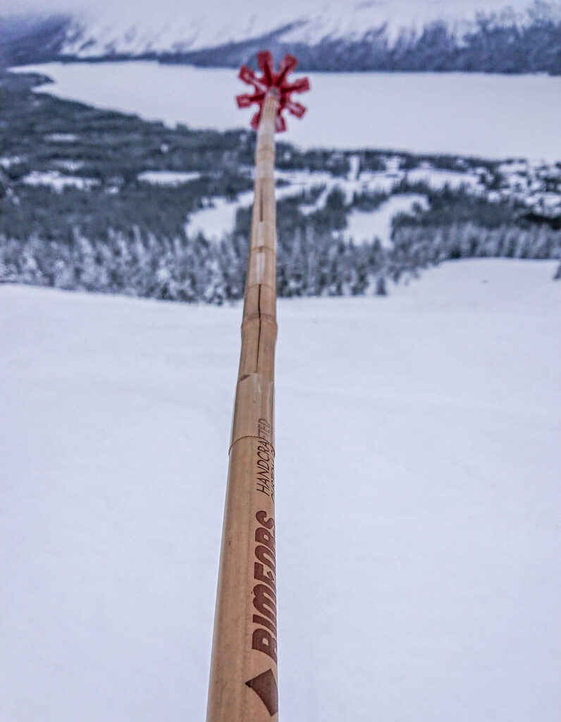 Broken bamboo ski pole fixed with tape to work fine again.